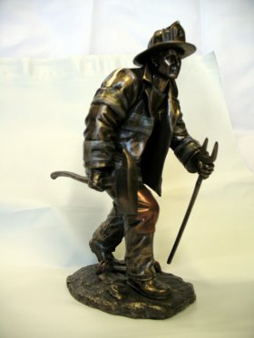 Fireman Fighting Fire Statue